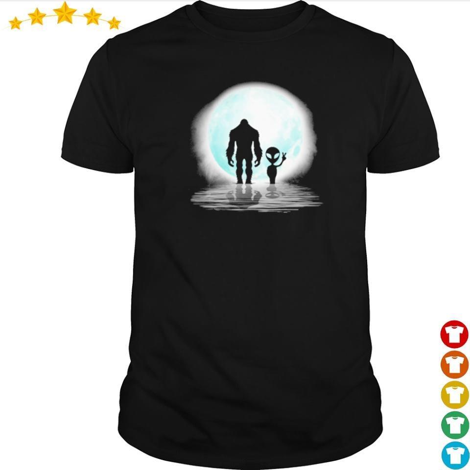 Big Foot walking under moon with alien shirt